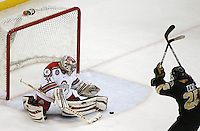 Ohio State goalie Brady Hjelle (1) stops a shot by Western Michigan's Mike Cichy (25) during a NCAA hockey game at Value City Arena, Friday, Feb. 15, 2013 in Columbus, Ohio. (Photo for the Dispatch by Mike Munden)
