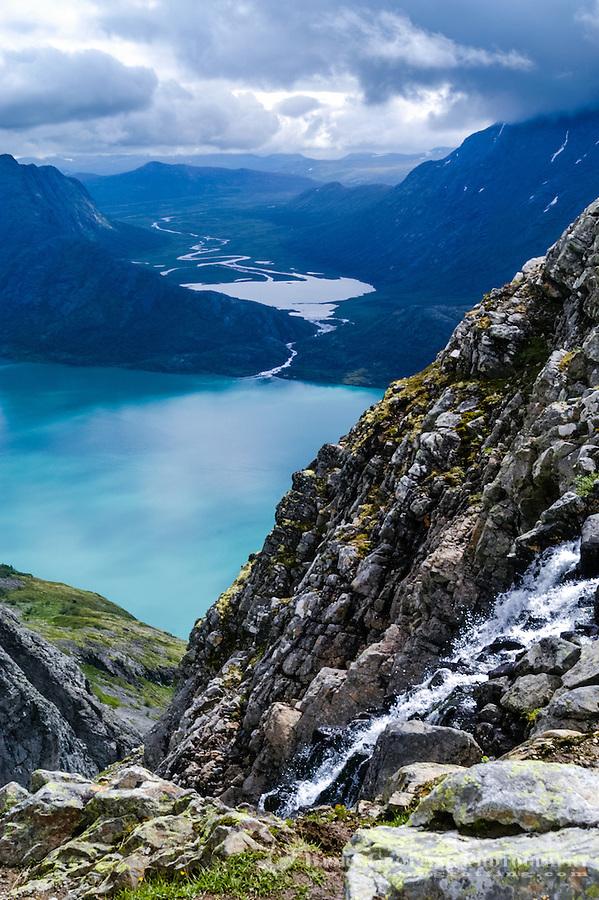 Norway, Jotunheimen. Hiking the famous Besseggen mountain ridge on the northern side of the Gjende Lake.