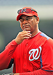 29 May 2011: Washington Nationals trainer Jose Martinez watches batting practice prior to a game against the San Diego Padres at Nationals Park in Washington, District of Columbia. The Padres defeated the Nationals 5-4 to take the rubber match of their 3-game series. Mandatory Credit: Ed Wolfstein Photo