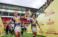 Picture by Alex Whitehead/SWpix.com - 23/08/2014 - Rugby League - Tetley's Challenge Cup Final - Castleford Tigers v Leeds Rhinos - Wembley Stadium, London, England - Leeds' Kevin Sinfield and Danny McGuire celebrate with the trophy.