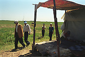 Tadjik refugees, with some Kyrgyz neighbours, in the village of Kara-Dube where they have settled and now work the land in small co-operatives with help from NGO's. Kara-Dube, Kyrgyzstan.
