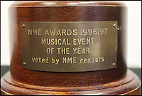 BNPS.co.uk (01202 558833)<br /> Pic: OmegaAuctions/BNPS<br /> <br /> A disfigured NME award Noel Gallagher smashed in anger at the lack of compassion shone to a fellow rocker who lost his life has emerged for auction.<br /> <br /> When the Oasis legend took to the stage 20 years ago to pick up the NME award for 'The Musical Event of the Year' for their mega concerts at Knebworth in August 1996, he was in no mood to celebrate.<br /> <br /> Instead, he vented his fury at the then NME editor Steve Sutherland for not acknowledging the death of The Charlatans keyboard player Rob Collins in the publication.<br /> <br /> The award - which the manager kept hold of for 20 years but has now decided to off-load - is valued at &pound;4,000.