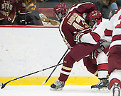 Johnny Gaudreau (BC - 13), Desmond Bergin (Harvard - 37) - The visiting Boston College Eagles defeated the Harvard University Crimson 5-1 on Wednesday, November 20, 2013, at Bright-Landry Hockey Center in Cambridge, Massachusetts.