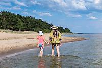 Mother and daughter walking on Kauksi beach. Lake Peipsi in Estonia.
