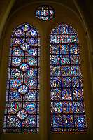 Medieval stained glass Window of the Gothic Cathedral of Chartres, France - dedicated to the Life of St Remigius (Remy). Left window - Labours of the Months / Signs of the Zodiac, right window -Life of the Virgin . A UNESCO World Heritage Site..