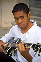 Young man playing the guitar.