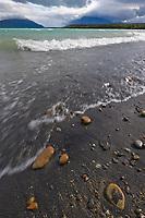 Waves break upon the shore of Naknek lake on a stormy day, Katmai National Park, Alaska.