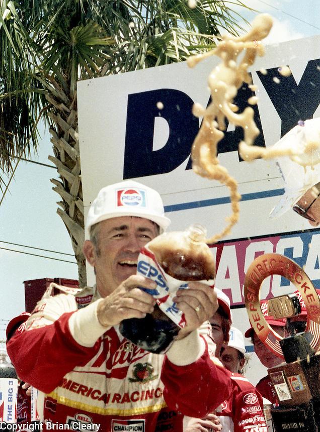 Bobby Allison sprays pepsi victory lane Pepsi Firecracker 400 Daytona International Speedway Daytona Beach FL July 1987 (Photo by Brian Cleary/www.bcpix.com)