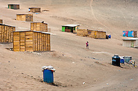 A young Peruvian mother carries her baby along wooden houses on the dusty hillside of Pachacútec, a desert suburb of Lima, Peru, 22 January 2015. Although Latin America (as a whole) is blessed with an abundance of fresh water, having 20% of global water resources in the the Amazon Basin and the highest annual rainfall of any region in the world, an estimated 50-70 million Latin Americans (one-tenth of the continent's population) lack access to safe water and 100 million people have no access to any safe sanitation. Complicated geographical conditions (mainly on the Pacific coast), unregulated industrialization (causing environmental pollution) and massive urban poverty, combined with deep social inequality, have caused a severe water supply shortage in many Latin American regions.