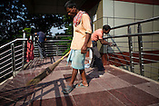 Construction workers polish and clean the overpass next to Jawahar Lal Nehru stadium in New Delhi, India.