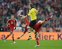 FUSSBALL   1. BUNDESLIGA  SAISON 2012/2013   15. Spieltag FC Bayern Muenchen - Borussia Dortmund     01.12.2012 Bastian Schweinsteiger (hinten, FC Bayern Muenchen) gegen Marco Reuss (oben, Borussia Dortmund)