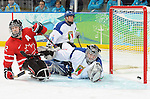Greg Westlake slides this puck past the Italian goaltender to give Canada a 2-0 lead in preliminary action at UBC Thunderbird Arena during the Paralympic Games in Vancouver. Credit: CPC/HC/Matthew Manor.