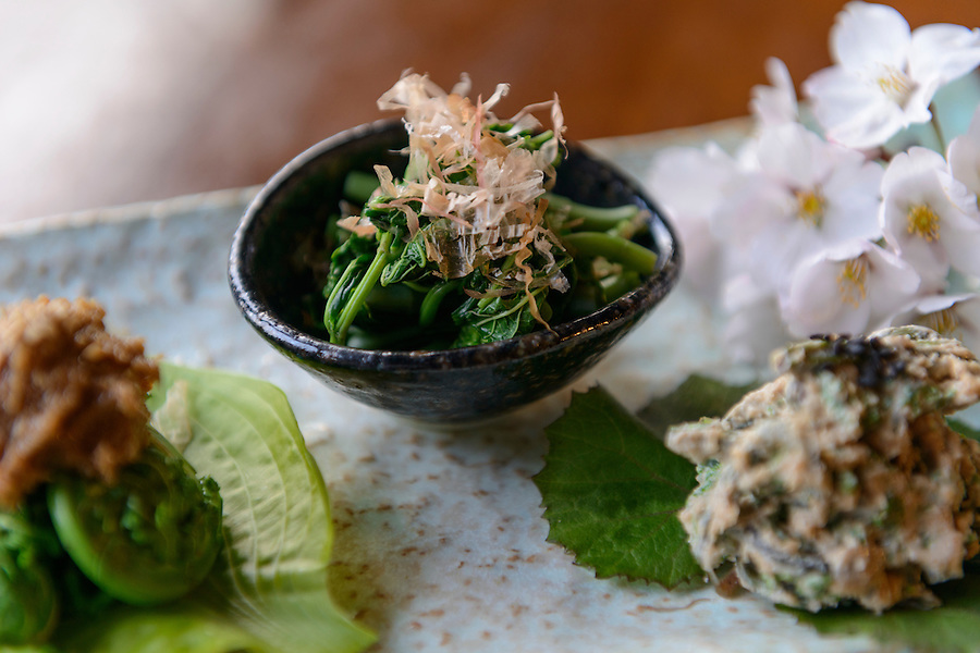 Dishes made with local mountain vegetables served at the Omoya Guesthouse. Tsuruoka, Yamagata Prefecture, Japan, April 10, 2016. The city of Tsuruoka in Yamagata Prefecture is famous for its sansai mountain vegetable cuisine. These foraged grasses, fungi and vegetables are also used by the mountain ascetics of the Shugendo religion.