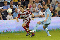 Zach Loyd (17) FC Dallas defender goes past Bobby Convey Sporting KC... Sporting KC defeated FC Dallas 2-1 at LIVESTRONG Sporting Park, Kansas City, Kansas.