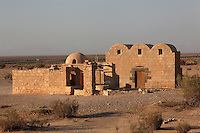 Qasr Amra desert castle, Jordan. The original castle complex was built in 723-743 by Walid Ibn Yazid, the future Umayyad Caliph Walid II. It was a fortress with military garrison and residence of the Umayyad Caliphs. Today only the royal pleasure cabin remains, with reception hall and hammam or bath house, decorated with frescoes. The 40m deep well is shown here. The building is of limestone and basalt and has a triple-vaulted ceiling with smaller domed rooms. Qasr Amra is a UNESCO World Heritage Site. Picture by Manuel Cohen