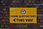 Newport County 1 Exeter City 1, 16/03/2014. Rodney Parade, League Two. Newport County finally return to the Football league after years of turmoil but a poor run of results has dented hopes of reaching the play-offs while Exeter City battle relegation. Sign showing the way in to the ground for Home supporters. Photo by Simon Gill