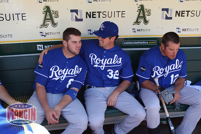 OAKLAND, CA - JUNE 16:  Mike Moustakas #8 and Vin Mazzaro #32 of the Kansas City Royals get ready in the dugout before the game against the Oakland Athletics at the Oakland-Alameda County Coliseum on Thursday, June 16, 2011 in Oakland, California. Photo by Brad Mangin