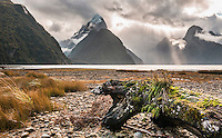Shafts of light penetrating sky over Milford Sound and Mitre Peak before sunset, Fiordland National Park, Southland, World Heritage Area, New Zealand