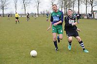 VOETBAL: ALDEBOARN:  14-04-2013, Eredivisie 2012-2013, Oldeboorn - Aengwirden, degradatiewedstrijd 4e klasse A, Eindstand 2-3, Sander Hylkema Aengwirden (#4), Rene Kalsbeek (#12)  ©foto Martin de Jong