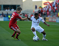 Toronto forward Joao Plata (7) maneuvers around Chicago midfielder Logan Pause (12).  The Chicago Fire defeated Toronto FC 2-0 at Toyota Park in Bridgeview, IL on August 21, 2011.