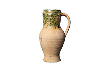 A terracotta pitcher with a handle, 14th century, from the excavations of 2009-10 led by Sebastien Ziegler, from the Latrines F288, rue de la Madeleine, at the medieval castle of Chateau-Thierry, Picardy, France. The first fortifications on this spur over the river Marne date from the 4th century and the first castle was built in the 9th century Merovingian period by the counts of Vermandois. Thibaud II enlarged the castle in the 12th century and built the Tour Thibaud, and Thibaud IV expanded it significantly in the 13th century to include 17 defensive towers in the walls and an East and South gate. The castle was largely destroyed in the French Revolution after having been a royal palace since 1285. In 1814 it was used as a citadel for Napoleonic troops. Picture by Manuel Cohen