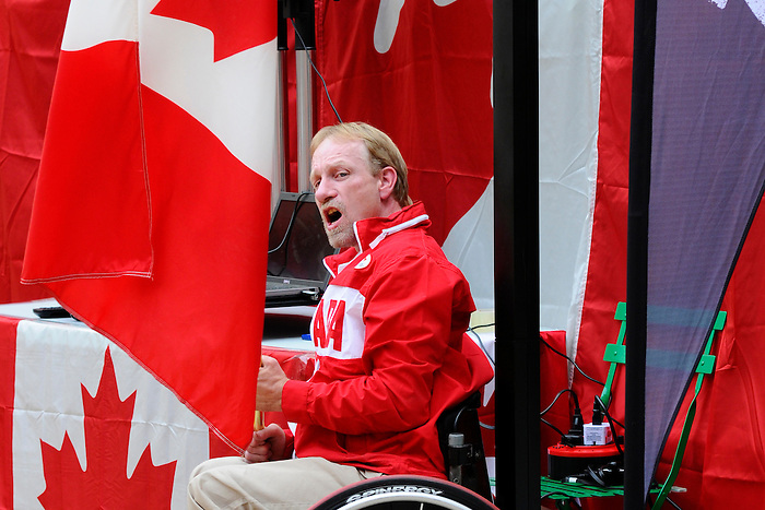 LONDON, ENGLAND 26/08/2012 -  Garett Hickling of Wheelchair Rugby takes centre stage after being announced as the flag bearer for the Opening Ceremonies during a pep rally at Canada House at the London 2012 Paralympic Games. (Photo: Phillip MacCallum/Canadian Paralympic Committee)