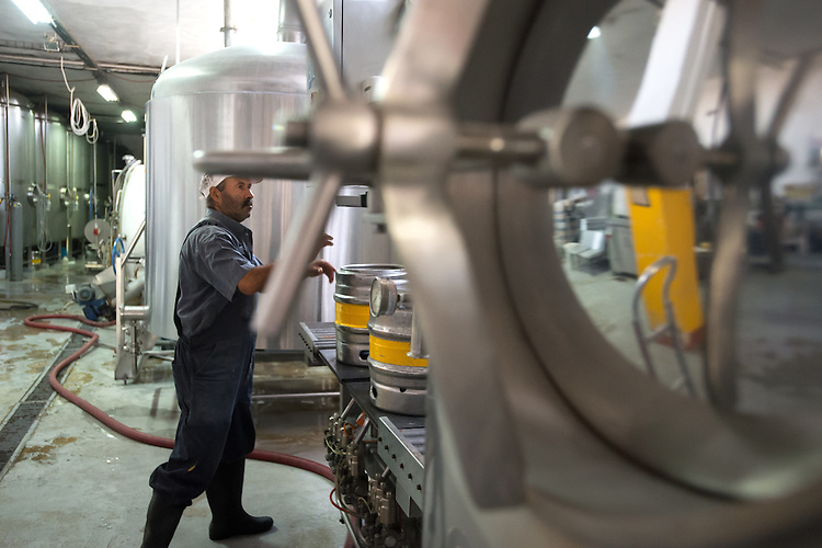 PALESTINE Taybeh, West Bank<br /> <br /> Taybeh Brewery Company:<br /> <br /> A worker the brewery.