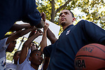 {June 27, 2012} {4:00pm} -- New York, NY, U.S.A.Duke basketball star Austin Rivers cheers with kids after playing ball at the Dunlevy Milbank Boys &amp; Girls Club in Harlem before the NBA draft Thursday in Manhattan, New York on June 27, 2012. .