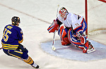 9 December 2006: Montreal Canadiens goaltender Cristobal Huet (39) of France makes a save against Buffalo Sabres center Jochen Hecht (55) from Germany at the Bell Centre in Montreal, Canada. The Sabres defeated the Canadiens 3-2 in a shootout, taking their third contest in the month of December. Mandatory Photo credit: Ed Wolfstein Photo<br />  *** Editorial Sales through Icon Sports Media *** www.iconsportsmedia.com