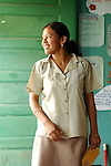 Primary teacher smiles in her classroom in southern Belize