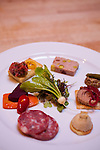 "Beast is a six-course, prix fixe restaurant in NE Portland, Oregon whose menu changes every Wednesday.  Chef Naomi Pomeroy (and single mom) and partner Micah Paredes focus on local ingredients in a style which they call ""refined French grandmother.""  Pictured here is the charcuterie plate: fois gras bon bon with a sauternes geleé, steak tartare & quail egg toast, pork, pork liver, sour cherry & pistachio pate, chicken liver mousse with pickled shallot."