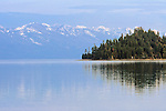 An island in Flathead Lake and the snow capped peaks of the Mission Mountains in western Montana