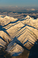 Fresh snow on the Alaska range mountains. Scott peak, the prominent pointed mountain, Denali National Park, interior, Alaska.