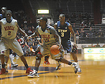 "Ole Miss guard Nick Williams (20) drives against East Tennessee State's Justin Tubbs (3) at the C.M. ""Tad"" Smith Coliseum in Oxford, Miss. on Saturday, December 18, 2010. Ole Miss won 71-50."