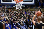 30 November 2014: Duke fans, the Cameron Crazies, try to distract an Army player shooting a freethrow. The Duke University Blue Devils hosted the West Point Military Academy Army Black Knights at Cameron Indoor Stadium in Durham, North Carolina in a 2014-16 NCAA Men's Basketball Division I game. Duke won the game 93-73.