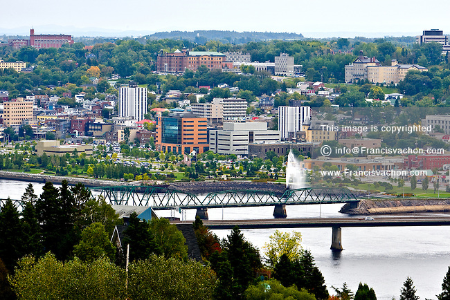 """The Saguenay borough of Chicoutimi skyline is pictured September 24, 2008. Located 225 kilometres north of Quebec City ,Chicoutimi is one of the three boroughs of Saguenay, Quebec, Canada, and was a separate city in its own right until 2002. Situated at the confluence of the Chicoutimi and Saguenay Rivers, the placename is derived from Shkoutimeou, meaning """"the end of the deep water"""" in the Montagnais dialect."""