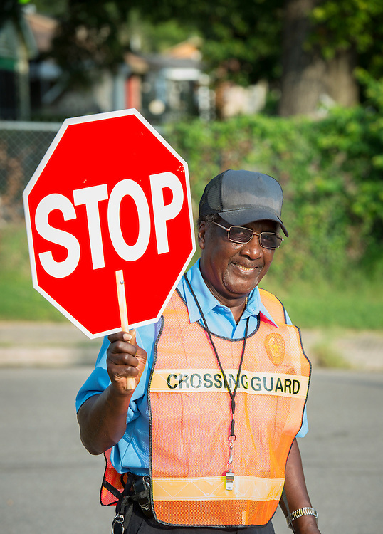 Houston ISD crossing guard Sherman Jefferson works as a crossing guard at Thompson Elementary School, July 14, 2014.