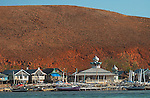 Colorful houses, boats and a mosque, Papagaran island, Komodo National Park