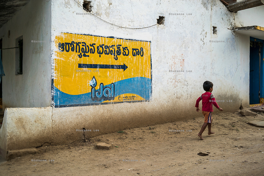 A child runs towards the iJal water station in Gorikathapalli, a remote village in Warangal, Telangana, India, on 22nd March 2015. Safe Water Network works with local communities that live beyond the water pipeline to establish sustainable and reliable water treatment stations within their villages to provide potable and safe water to the communities at a nominal cost. Photo by Suzanne Lee/Panos Pictures for Safe Water Network