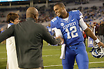 Coach Joker Phillips congratulates senior Kentucky Wildcats quarterback Morgan Newton (12) before the UK Football game v. Samford at Commonwealth Stadium in Lexington, Ky., on Saturday, November 17, 2012. Photo by Genevieve Adams | Staff