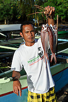 Fisherman with his catch, Dudepo, Bolmong Selatan, Sulawesi, Indonesia.