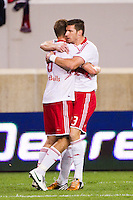 Kenny Cooper (33) of the New York Red Bulls celebrates scoring with Jan Gunnar Solli (8). The New York Red Bulls  defeated the Portland Timbers 3-2 during a Major League Soccer (MLS) match at Red Bull Arena in Harrison, NJ, on August 19, 2012.