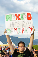 Young political protestor holding up a sign at the Mexico Fest 2012 celebrations on Sept. 8, 2012 in Vancouver, British Columbia, Canada. These celebrations commemorated 202 years of Mexican Independence.