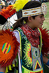 "Adolescent boy dressed in regalia celebrating his Native American heritage and ethnic pride at Pow Wow.....A pow-wow (also powwow or pow wow or pau wau) is a gathering of North America's Native people. The word derives from the Narragansett word powwaw, meaning ""spiritual leader""."