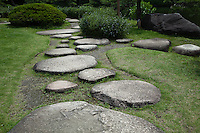 Stepping Stones at Kiyosumi Teien Garden -  the site of the residence of the Edo Period business magnate, Kinokuniya Bunzaemon. Later it became the residence of the Lord of Sekiyado castle, the period when the basic form of the garden came into existence.  In 1878  Iwasaki Yataro chose this property as a garden for the entertainment of important guests. In later years, famous rocks from all over Japan were brought in to embellish the garden. The garden was completed in the Meiji Period and developed into a famous strolling garden centered around a large pond.