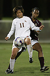 7 November 2007: Florida State's Mami Yamaguchi (11) controls the ball in front of Boston College's Kia McNeill. Florida State University defeated Boston College 1-0 at the Disney Wide World of Sports complex in Orlando, FL in an Atlantic Coast Conference tournament quarterfinal match.