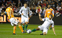 Chicago midfielder Peter Lowry (8) slide tackles the ball away from Houston forward Brian Mullan (9).  The Chicago Fire defeated the Houston Dynamo 2-0 at Toyota Park in Bridgeview, IL on April 24, 2010.