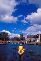 A sea kayaker paddles on Lake Superior in the lower harbor of Marquette, Mich.