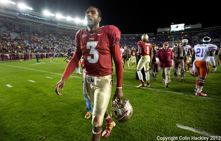 TALLAHASSEE, FL 11/24/12-FSU-UF112412 CH-Florida State's EJ Manuel walks off the field after Florida beat the Seminoles 37-26 Saturday at Doak Campbell Stadium in Tallahassee. COLIN HACKLEY PHOTO