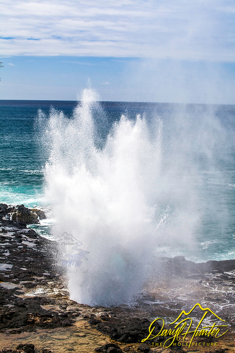 Poipu Kauai's Spouting Horn.  On Kauai's South Shore you'll find the spectacular Spouting Horn blowhole, one of the most photographed spots on Kauai. The Poipu surf channels into a natural lava tube here and releases a huge spout of water during large swells. You'll also hear a hiss and a roar that is the basis of a Hawaiian legend.
